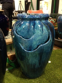 Picture of a turquoise glazed self contained fountain.