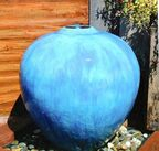 Picture of an outdoor globe style self contained fountain in teal.